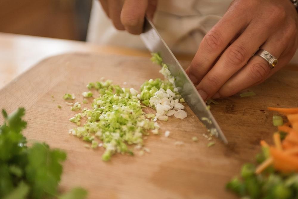 Chopping green garlic
