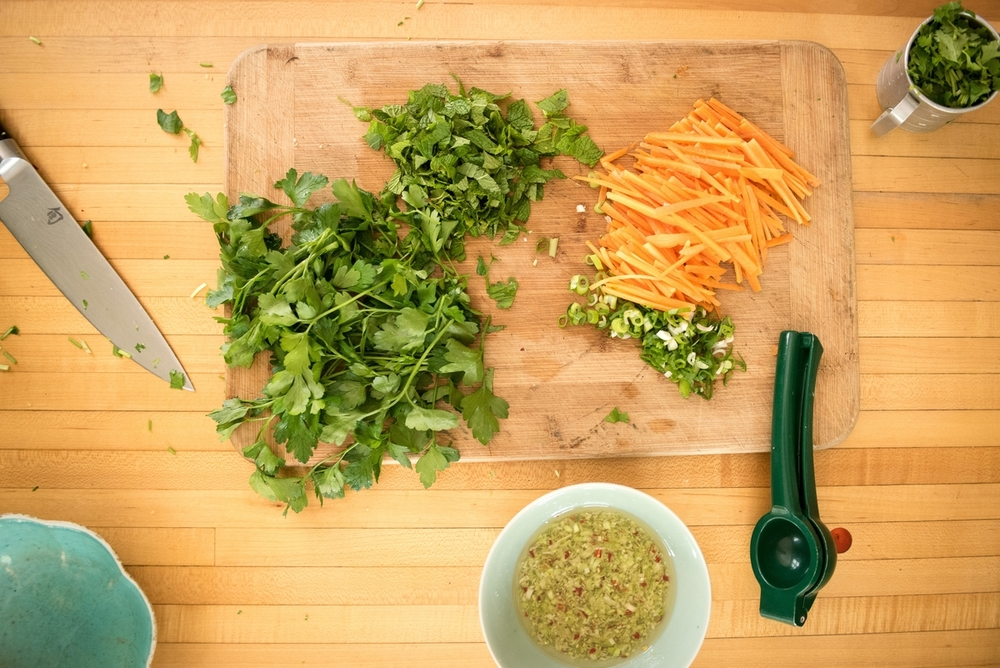 Carrots, herbs, and dressing prepared for Umi Organic fresh ramen noodles