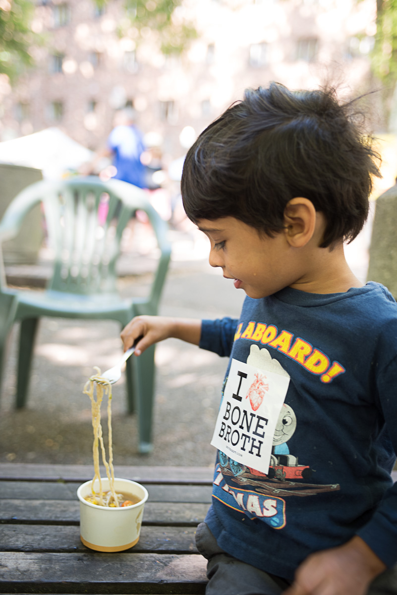 Sebi loves noodles and apparently hearts bone broth, too! We sampled our noodles with beef bone broth at the downtown Portland farmers market in early September. Photo by Shawn Linehan.