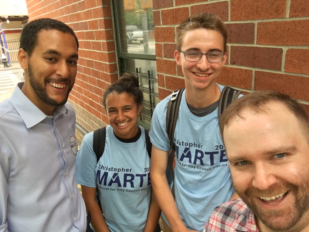 Christopher Marte, LIT's endorsed candidate for City Council District 1, with Robby Gonyo and other campaign volunteers.
