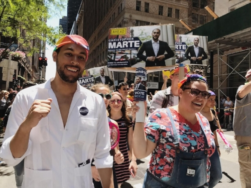 Mr. Marte walking during Pride.