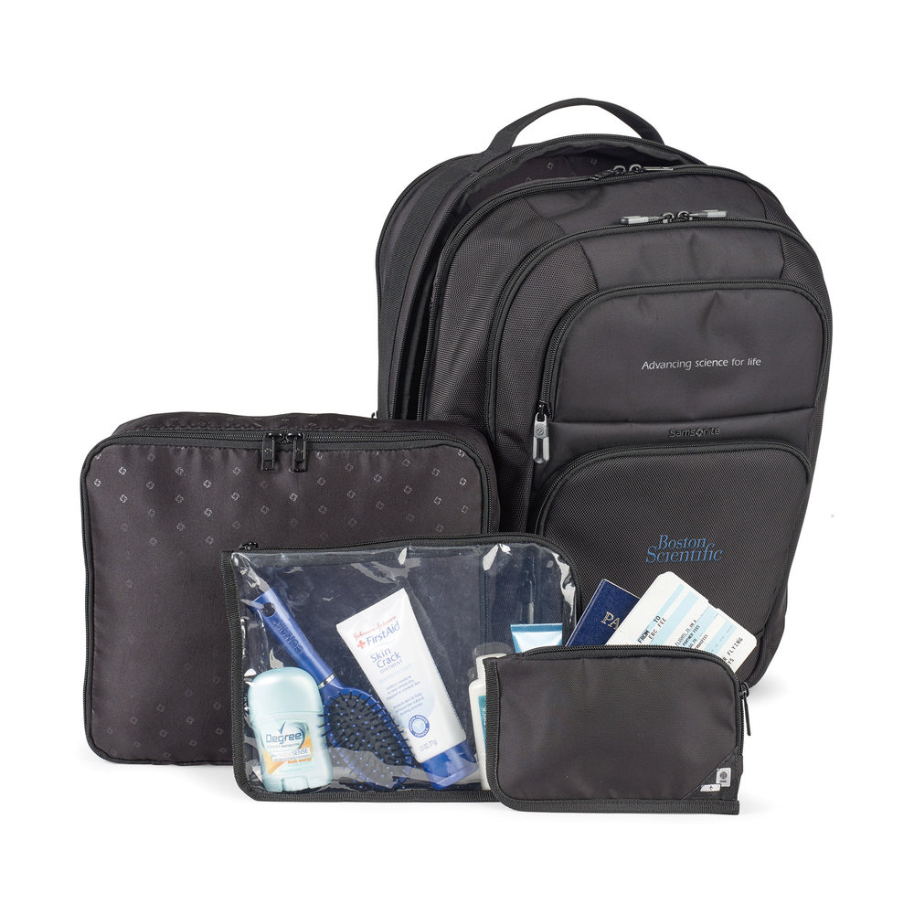 Packing cube, TSA friendly amenity case, and travel document pouch included.