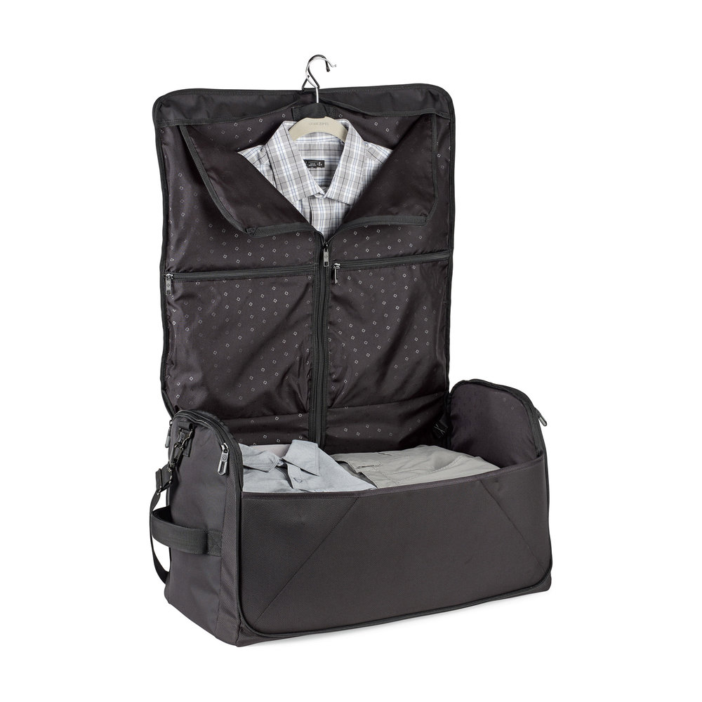 Garment bag feature is sized to hold a large men's suit and extends into the bottom panel of the duffel to allow pants or long dresses to lay flat.
