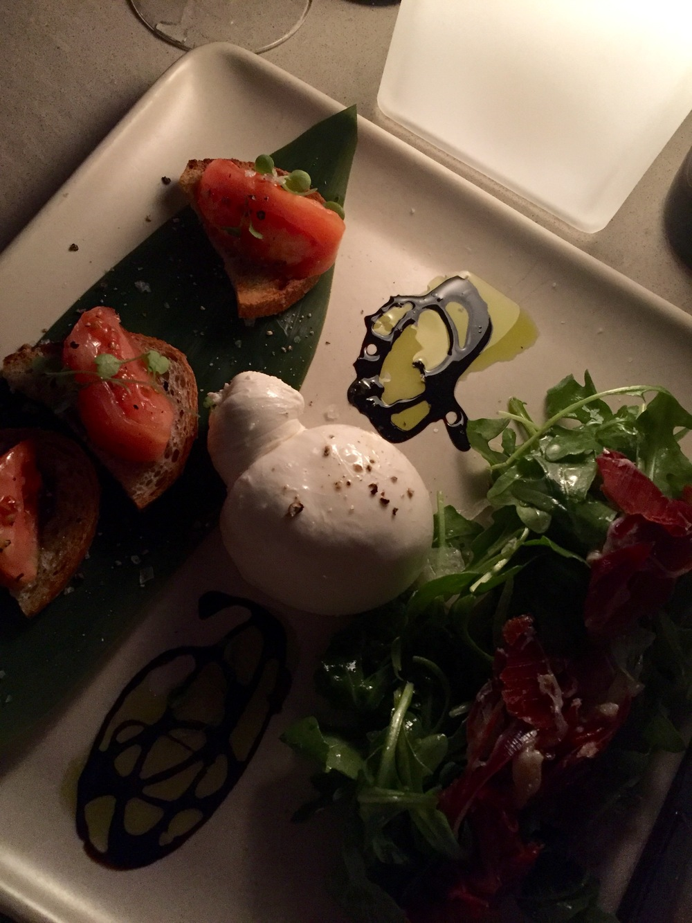 my meal: burrata with pata negra and tomato toast with arugula