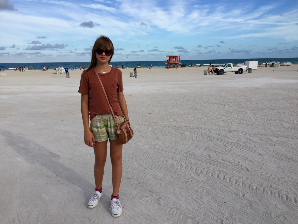 t shirt from  J Crew , shorts from  Ace & Jig , purse from  Athe  and suglasses from  Quay