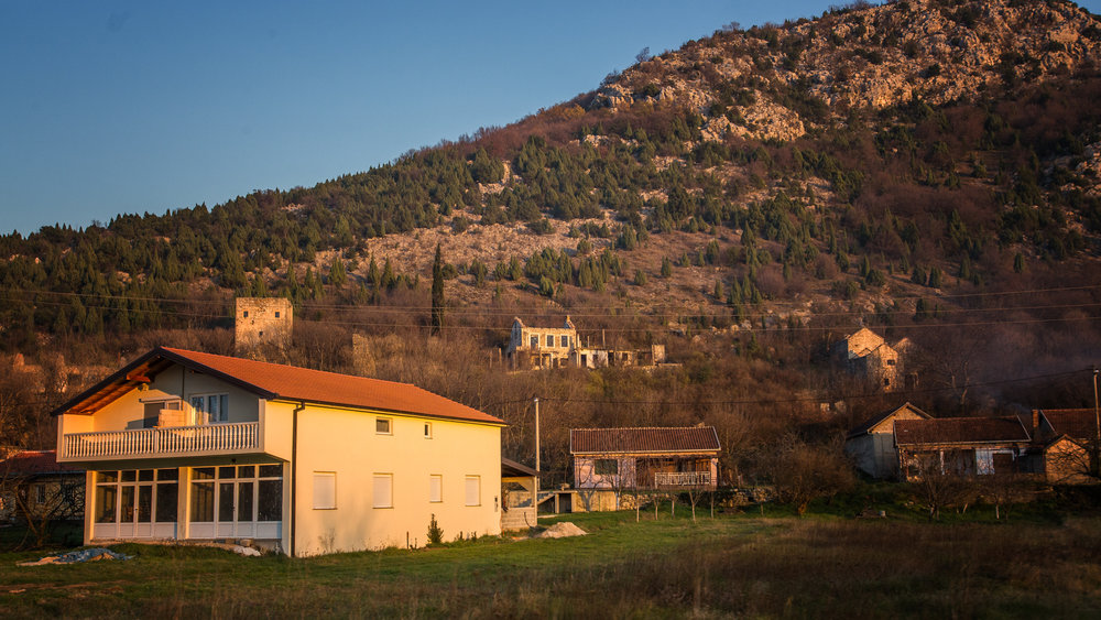The stone houses along the Bosnian countryside seem like they'd fall over in a strong breeze.