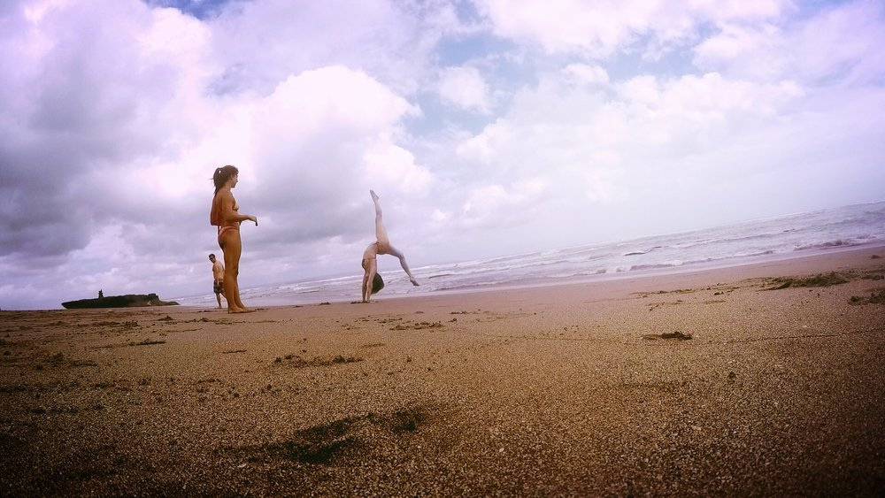 She's also the best beach gymnastics partner when you're flipping on the sand in Bali.