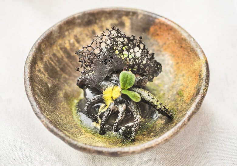 A dish from Chef Miguel Aguilar plated on work from Alyce Barr. Photo courtesy of Amy Lee Studios.