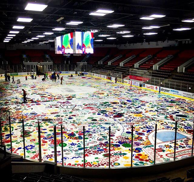 Collaborative painting on the K-Wings ice, from 2015. Source: http://mihockeynow.com/2015/01/kids-paint-kalamazoo-wings-ice-surface/