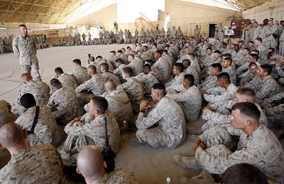 Marines listening to Gen. Michael Hagee in Al Asad, Iraq, 2006. (See page for author [Public domain], via Wikimedia Commons.)