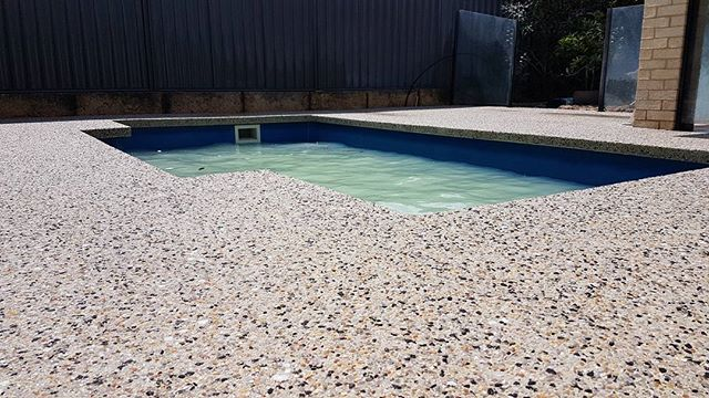 Pool Washed off today !  Forget those bullnose pavers!! Exposed Aggregate with seamless pool edge !  #hollywood #exposedaggregate #perth  Formwork for pool edge by our friends at All Class Concrete
