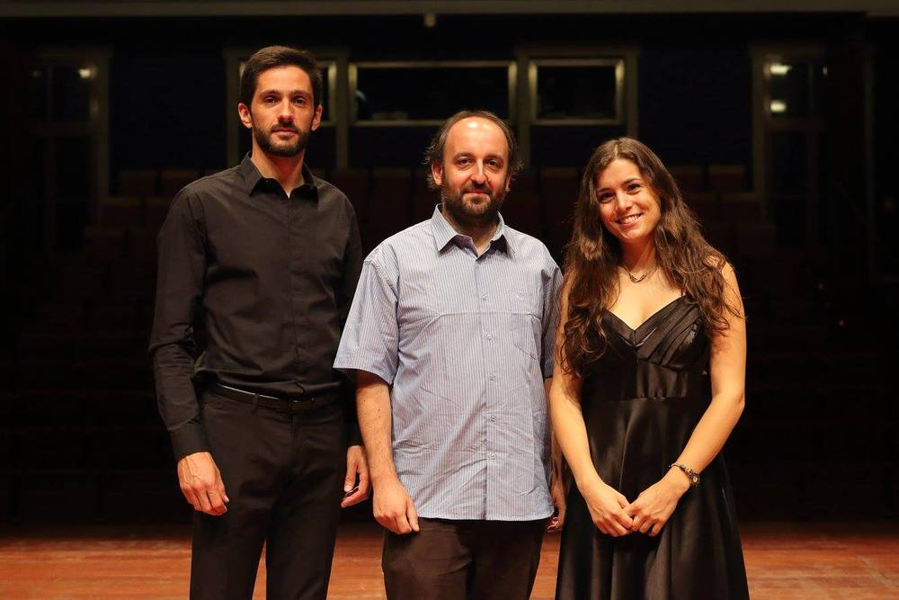 Flutists André Cameira and Patrícia Pires, with composer Ricardo Matosinhos, center