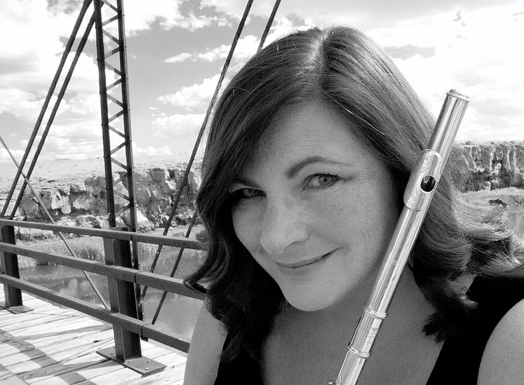 Powell Flutist Tracy Doyle, with a beautiful out-West, Colorado background