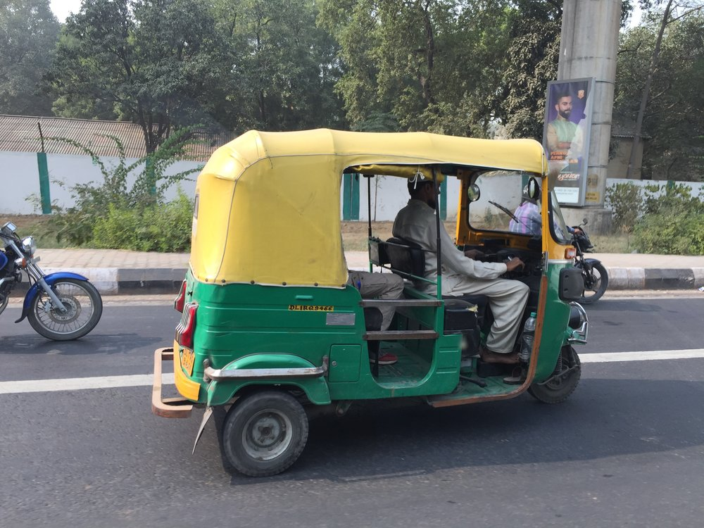 One of many different modes of transport in Delhi — great colors!