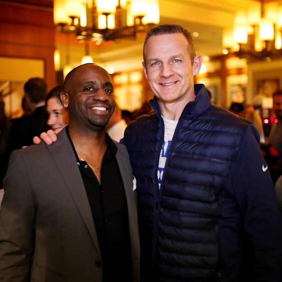 Leon C. McKenzie with TV personality and former NFL player Merril Hoge at the Sure Sports Lending Annual NFL Combine Cocktail Party.