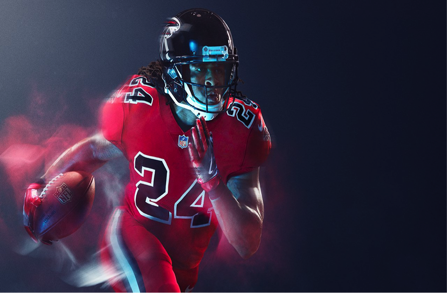 Nike did a great job with the black helmets and numbers. I just hate to see this look so similar to their normal red unis.