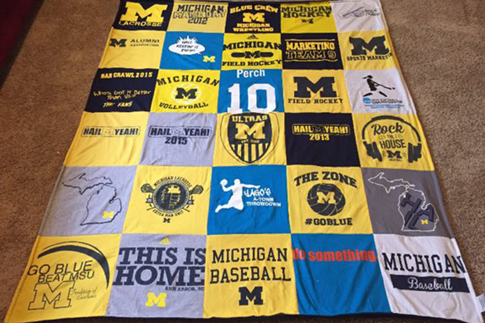 Katie Prchlik, Utah State University Marketing Assistant, created this blanket from shirts she accrued as a student at Michigan.