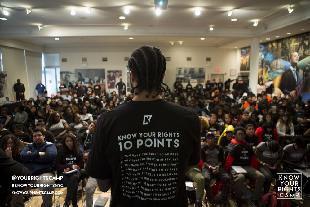 Colin Kaepernick speaking to at-risk youth at his Know Your Rights Camp in New York City.Image via www.knowyourrightscamp.com
