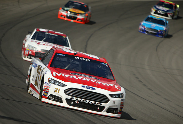 RCR's Ryan Newman chases down Wood Brothers driver Ryan Blaney. Photo via zimbio.com