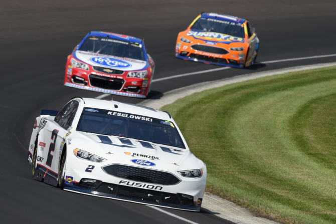 Brad Keselowski (foreground) leads A.J. Allmendinger and Ricky Stenhouse Jr. Photo from cnd.inquistir.com