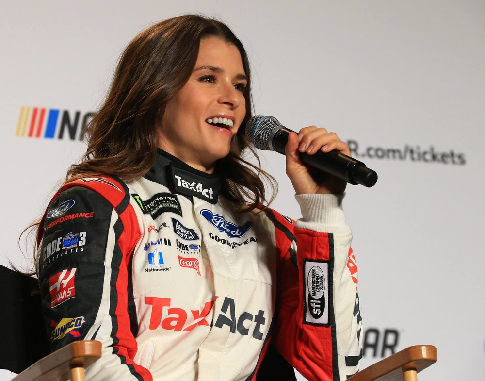 Danica Patrick speaks to the media while wearing her Tax Act fire suit. Nature's Bakery ended its sponsorship agreement with Patrick and her No. 10, but Tax Act and others still remain on board. Image from Racing News.