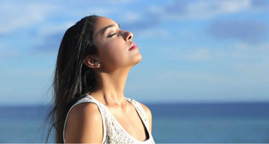 Deep breathes in the morning can help start your day on the right foot. Photo via awaken.com