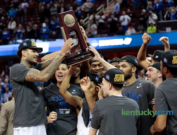 The 2015 Kentucky Wildcats celebrate a Final Four birth in the NCAA March Madness Tournament. Photo via Kentucky.com