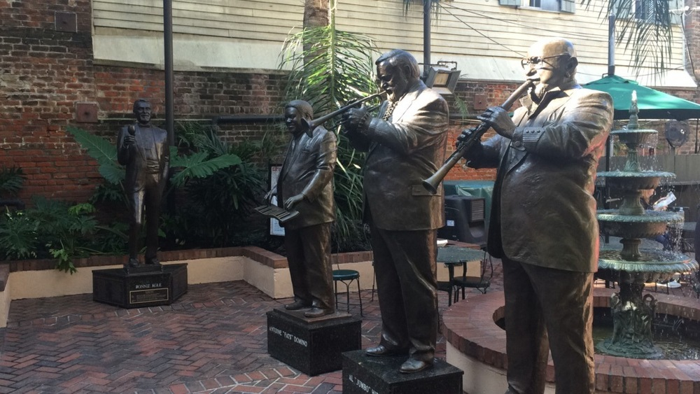 "Statues of the famous Al ""Jumbo"" Hirt, Antoine ""Fats"" Domino, Pete Fountain & Ronnie Kole at Café Beignet, Bourbon Street New Orleans."