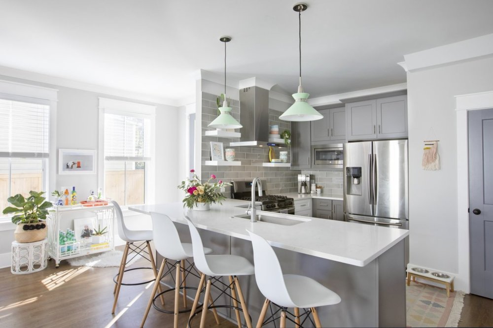 grey and white kitchen with mint green lights