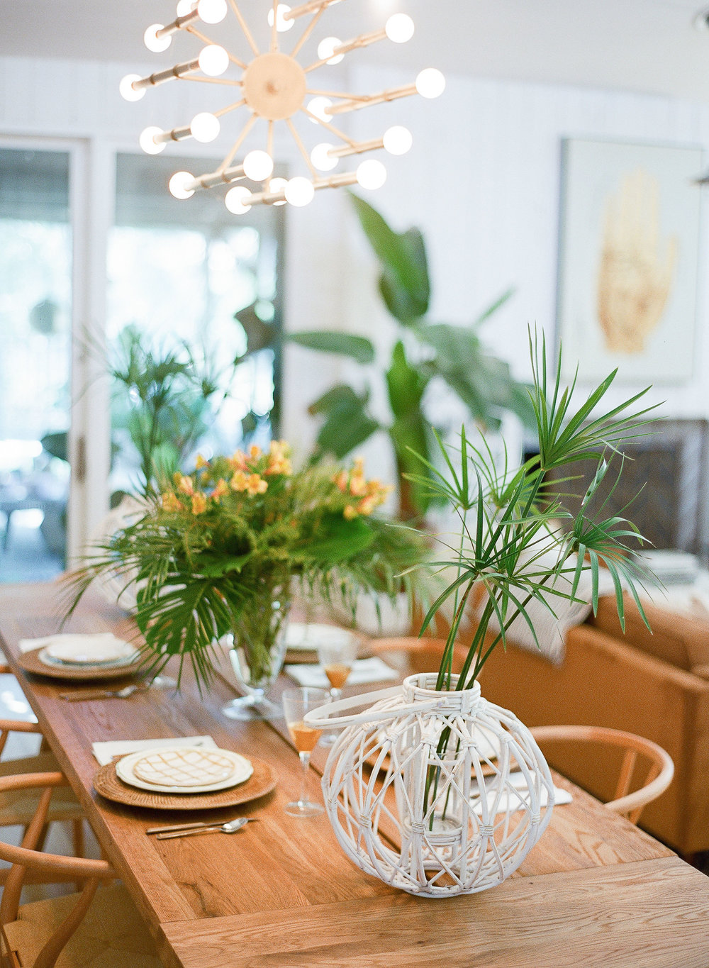 Natural tablescape with wooden elements and tropical plant centerpiece