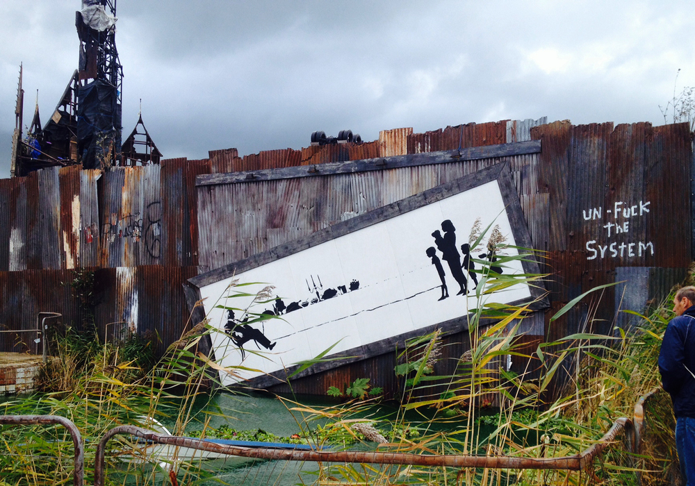 Banksy's iconic spray-paint work is displayed throughout the theme park.