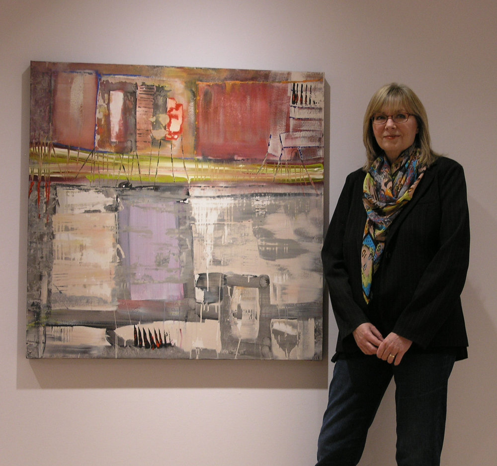 Loretta Kaltenhauser with one of her sold paintings