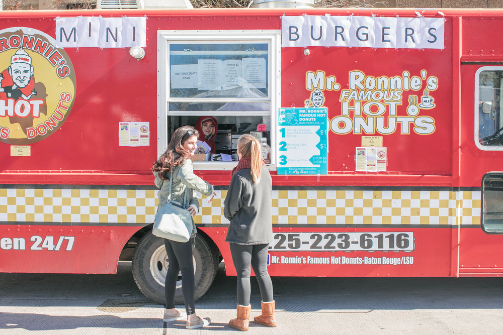 Foodie friends deciding on their order from Baton Rouge's Mr. Ronnie's Famous Hot Donuts truck. The Mr. Ronnie's team was also serving up mini burgers at the fest.  OA