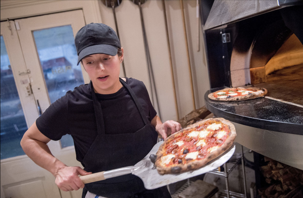 Kate doing her thing with the wood-fired oven at Echo's. [Photo by J.T. Blaty for  The Advocate ]