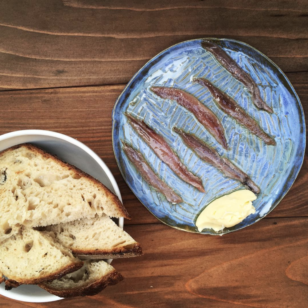 Fresh Sourdough and anchovies at Echo's. Who else could literally eat an entire loaf to themselves? [Photo via  Echo's Pizza ]