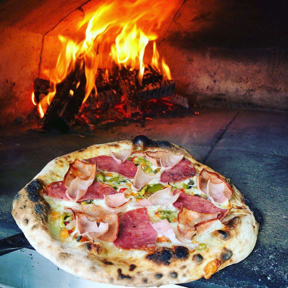 Dat'z a N'Awlins Muffaletta Pizza:Salami, Mortadella, Chisesi's Ham, Olive Salad, Mozzarella/Provolone Cheese.