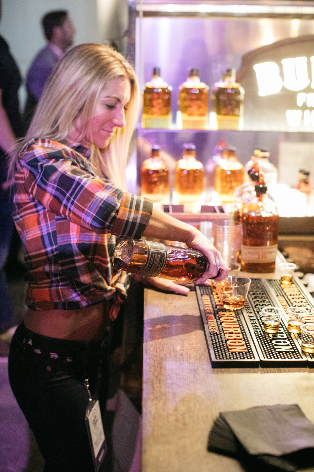 Bulleit Bourbon being served by a bartender. Photo by  Ollie Alexander .