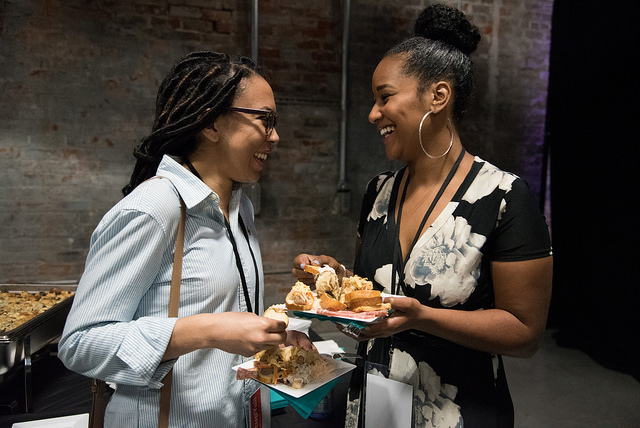 People enjoying the meal served by Elysian Seafood at New Orleans Entrepreneur Week. Photo by  Monwell Frazier .