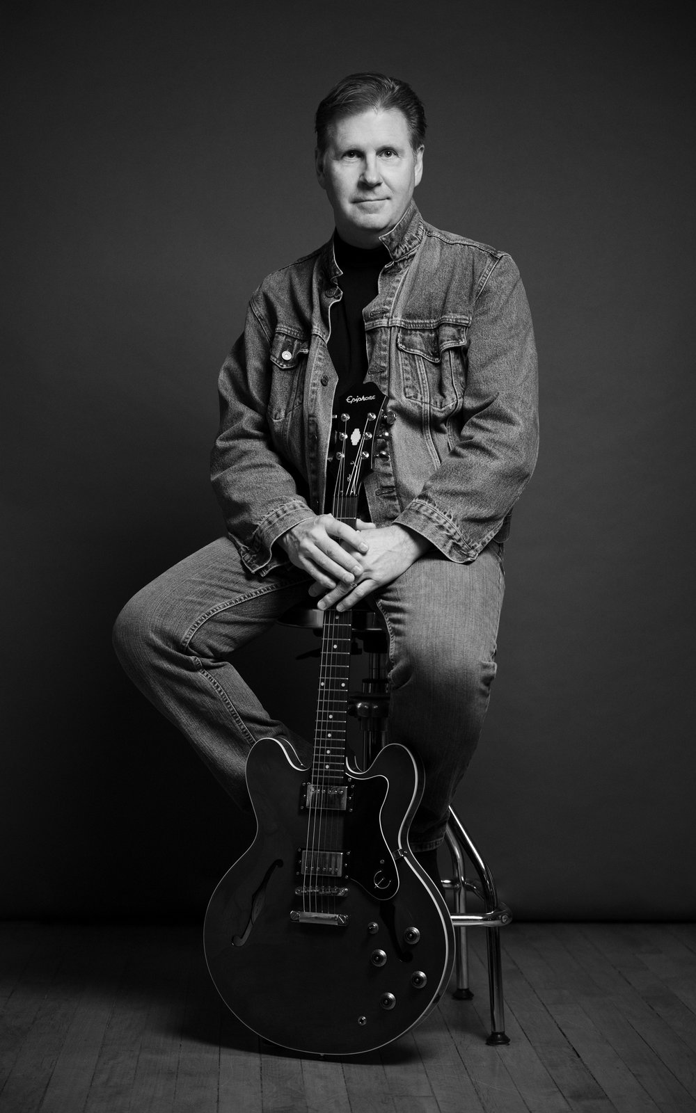 Marta-Hewson-editorial-portraits- denim-jacket-electric-guitar-John-Loeprich.jpg