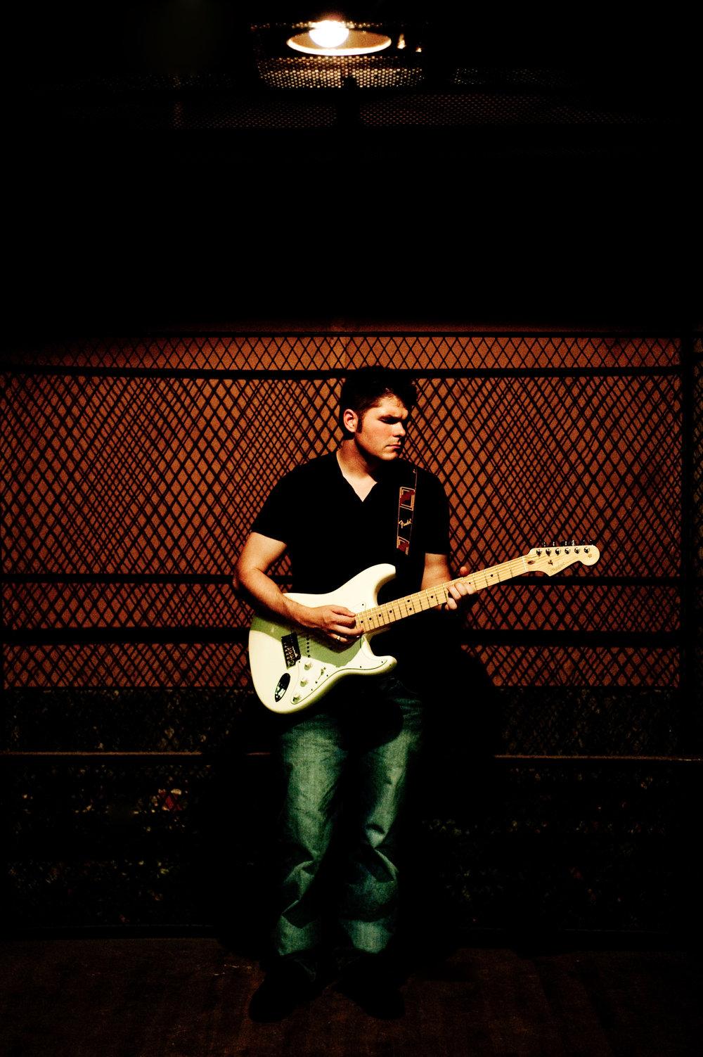 Marta-Hewson-editorial-portraits-electric-guitar-Andre-Bison.JPG
