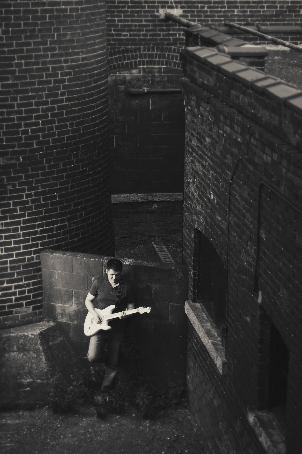 Marta-Hewson-editorial-portraits-electric-guitar-the-Cotton-Factory-Andre-Bison.jpg