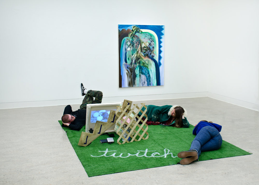 Installation image:    Twitch,  Astro turf, spray paint, oil paint, canvas, wood, concrete, plaster, video projection