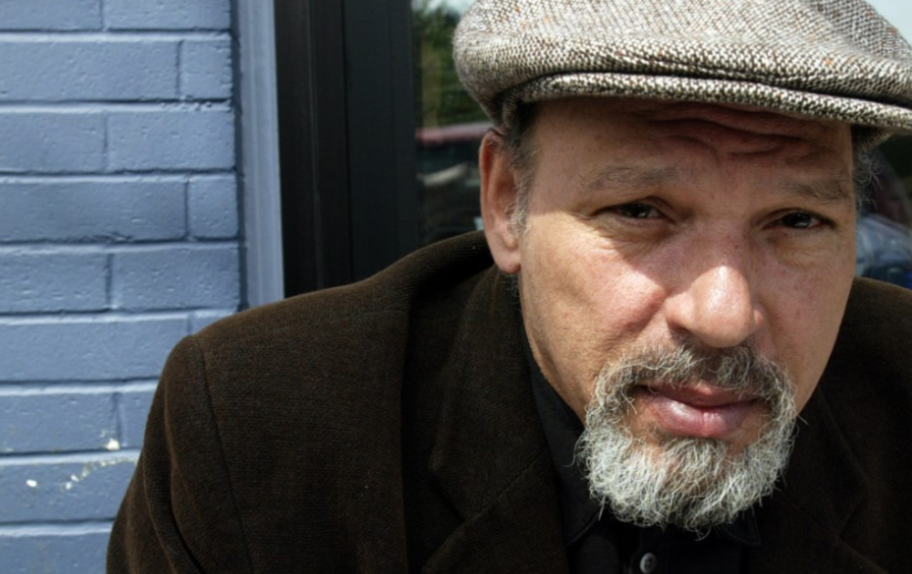 August Wilson. The playwright was born to a black mother and white father.