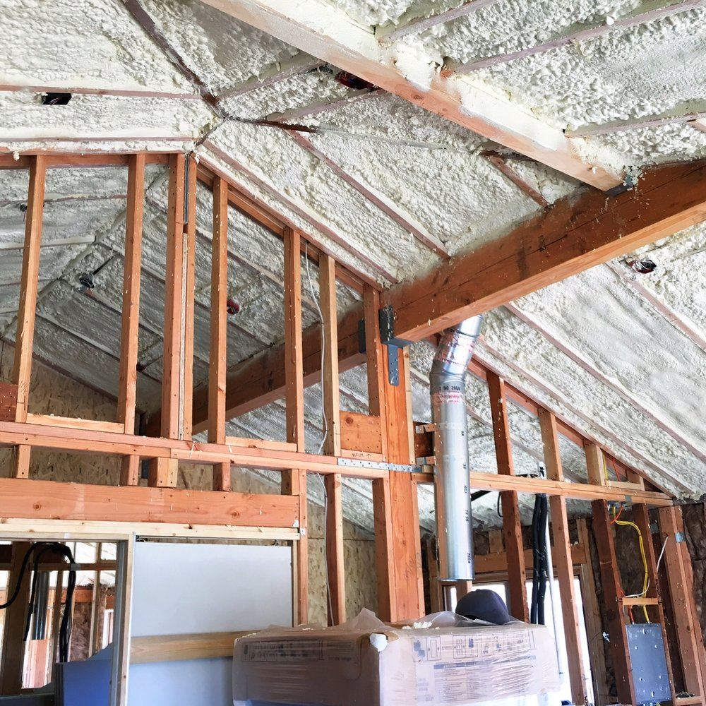 Many states have new energy codes. It means big change for the construction industry... 🛠Things like this spray foam insulation in order to get a vaulted ceiling! 😃 It's so worth it. This apartment will look amazing when it's done... Also, doesn't it look like backwards snow?? ❄️