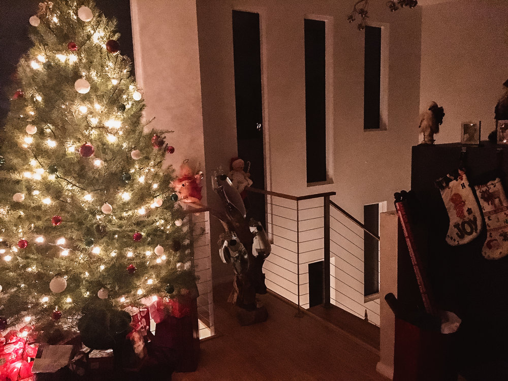 Woah, those windows make that Christmas tree look gooooooood. 🎄 Holidays at my parent's house are so much sweeter in a house of our own design. My favorite Christmas decorations are those stockings, handmade by my Mom. ❤️🌟 What's your favorite holiday decoration?