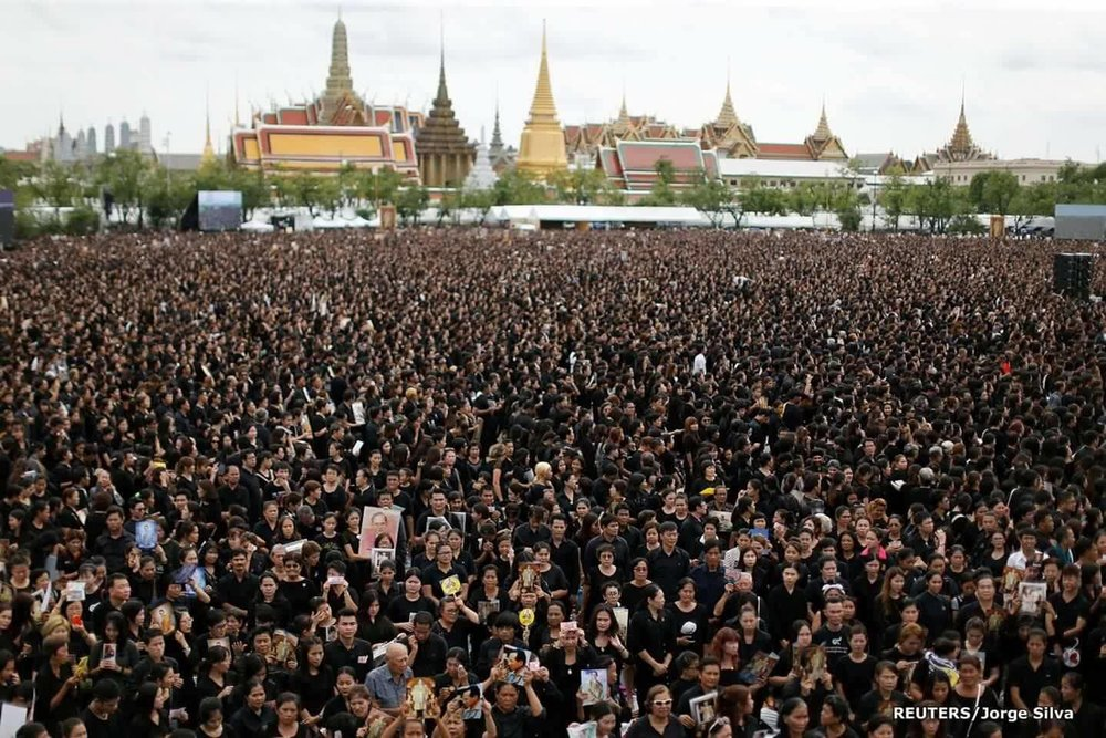 The crowd that gathered in Sanam Luang and surrounding streets has been estimated at anywhere from 177,000 people to half a million or even (according to the Khmer Times) one million people.  If not the biggest, it was clearly one of the vastest assemblies ever to perform a nation's song.
