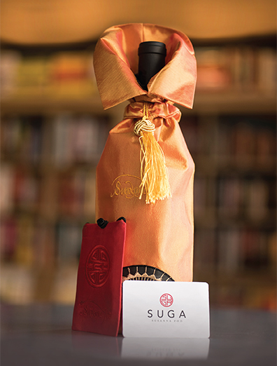 The gift card package shown above includes a silk purse and wine bag, which can only be purchased at our 1720 Sansom street location.