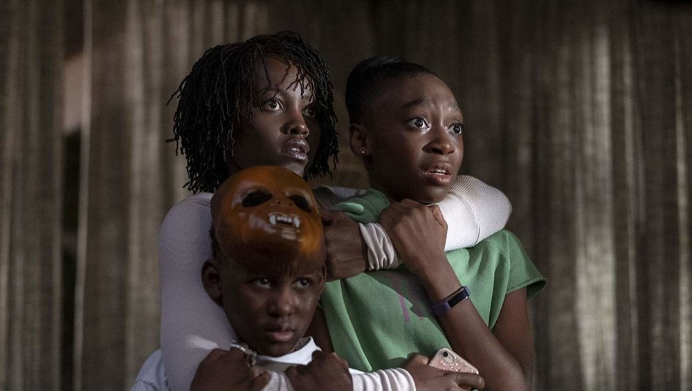 SYFYWIRE | THE REAL HORROR IN JORDAN PEELE'S US: CAPITALISM AND CLASSISM - When watching the film for the first time, I not only saw Peele's point about duality, but also a love letter to classic horror films. But, after watching it for a second time, I began to see the movie as being a startling reminder of how awful classism and capitalism can be, and how, if you are not wise, it can have you tethered to the darker parts of yourself.