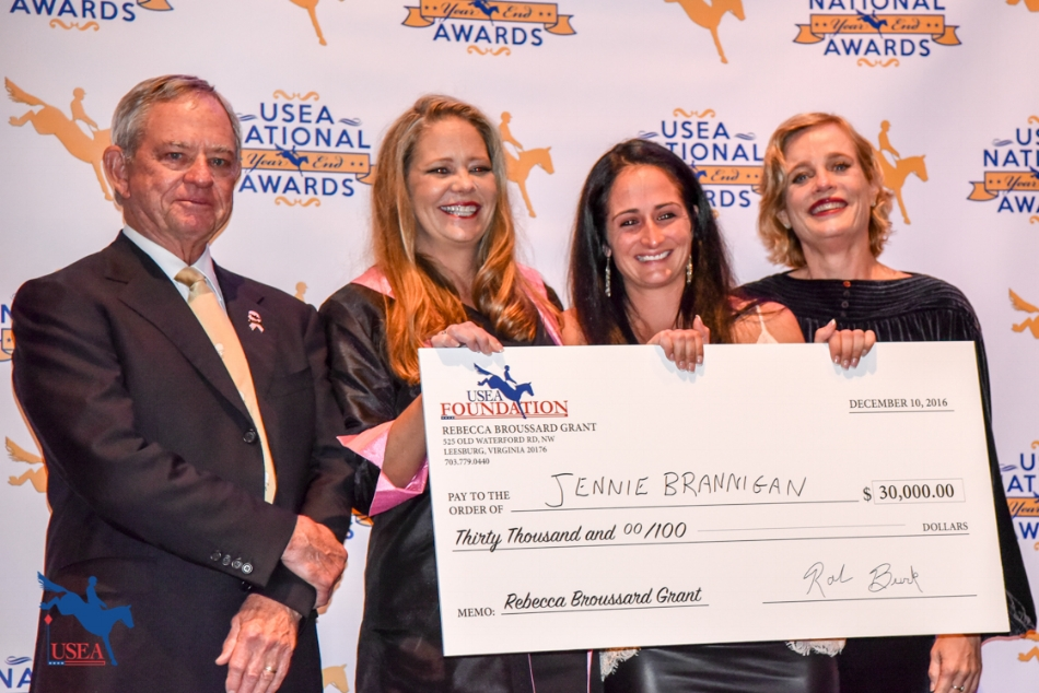 Jennie Brannigan was overjoyed to receive the Rebecca Broussard International Developing Rider's Grant and a check for $30,000 from the Broussard family at the USEA Annual Meeting and Convention this weekend. The grant is in memory of Jerome's Broussard's late wife Rebecca who had a long-held dream to help talented riders achieve their goal of one day representing the USA on an international Team. L-R: Jerome Broussard, Sarah Broussard, Jennie Brannigan and Rebecca Broussard.