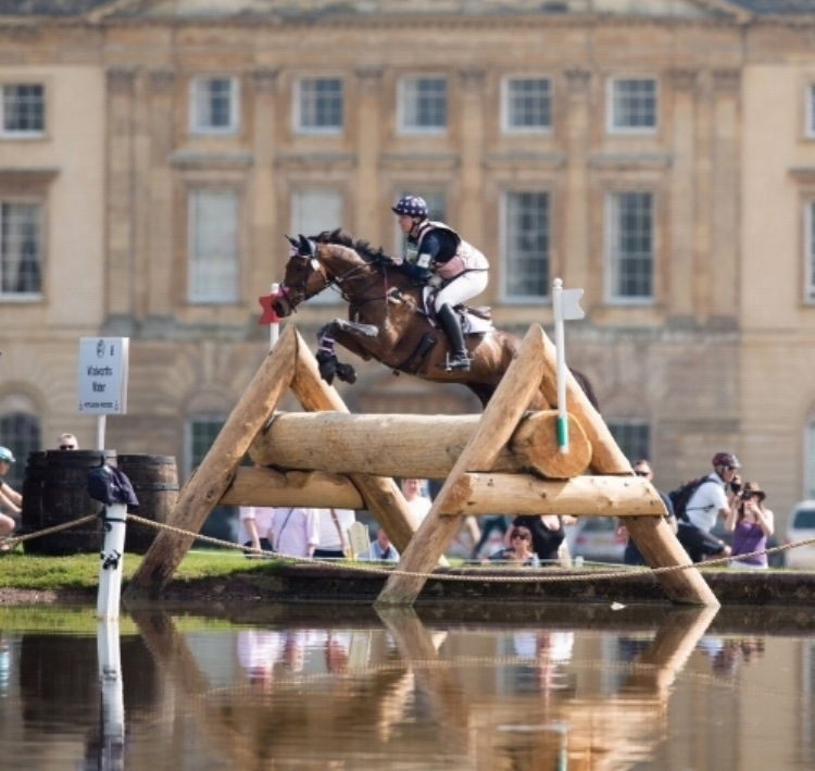 P.S. Arianna soars over Fence 8 in front of Badminton House.